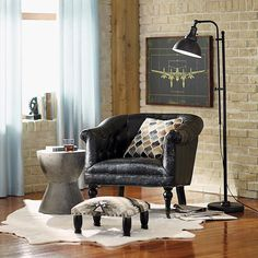 rustic brick industrial homedecor leather interiordesign Exposed #brick is the perfect place to experiment with #industrial accents. Plush touches like an animal-inspired rug keep the look warm! Head to the link in our profile to bring this look home. #homedecor #interiordesign #rustic #leather