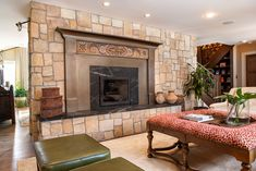Custom Steel fireplace surround, with earthy accents. From Raw Urth Designs.