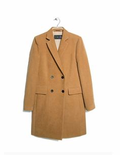 Every wardrobe should have a classic camel coat. This one gets our vote. Mango coat.