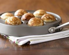 """YUM. Ebelskiver pan... """"A beloved treat in Denmark, ebelskivers are light, puffy pancakes that can be filled with fruit, chocolate, jam or cheese and served for breakfast or as an hors d'oeuvre."""" Williams-Sonoma"""