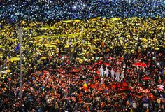 <p>People light the flashes of their mobile phones in the colours of Romania's flag during an anti-government protest in Bucharest, Romania. (Rex) </p>