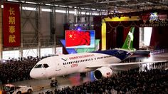 The first twin-engine 158-seater C919 passenger plane made by The Commercial Aircraft Corp. of China (COMAC) is pulled out of the company's hangar during a ceremony near the Pudong International Airport in Shanghai, China, Nov. 2, 2015. (AP Photo)