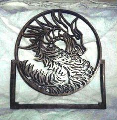 Wooden scroll saw dragon profile in frame