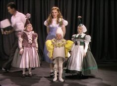 A rare test photo from the Wizard of Oz (1939) with three Munchkins and Judy Garland in the original blond wig
