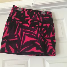 Pink, purple, and black mini skirt Pink, purple and black mini skirt. Great condition! Only worn twice! Express Skirts Mini