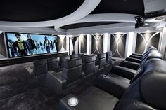 home theater showing the screen along with the chairs.