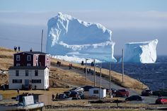 High winds have grounded a huge iceberg on the Newfoundland shore, to the delight of camera-wielding sightseers.