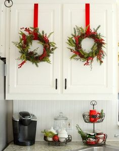 maybe command hooks to keep the wreaths from flopping around evry time you open and close the cabinet doors ;-)