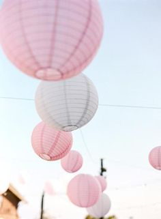pink and white paper lanterns outdoor event
