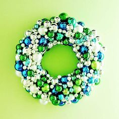 Sparkling Ornament Wreath.. Varied size/color cheap inexpensive ornaments both shiny & matte finish. Hot glue to wreath form......