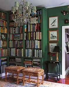 french accents by erin swift, green walls, green bookshelves, upholstered stools, home office, library, den
