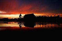A Chinese man rides a bicycle across Tiananmen Square before the customary ceremony of lowering the flag, June 9, 2012, in Beijing, China. (Feng Li/Getty Images)