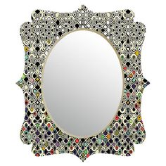 Add a pop of mod style to your entryway or powder room with this eye-catching mirror, featuring a Baroque-inspired silhouette.  Prod...