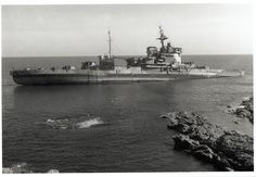 """While under tow to the breakers yard, the """"Grand Old Lady"""" HMS Warspite, defied the breakers torch and went aground at Prussia Cove in Cornwall.  Resisting all attempts to get her to the scrapyard, she was eventually towed to Marazion, where she was eventually broken up in situ in 1955. Many people, myself included, feel that as she won a total of 14 battle honours in two world wars, she deserved a better fate than the breaker's yard and should have been preserved for a grateful nation as…"""