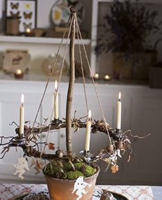 Candle wreath suspended over garden pot. Place several along the festive table f… - Candle wreath suspended over garden pot. Place several along the festive table f… Candle wreath suspended over garden pot. Place several along the festive table f… Natural Christmas, Noel Christmas, Christmas Is Coming, Rustic Christmas, Winter Christmas, Vintage Christmas, Christmas Crafts, Yule Crafts, Christmas Advent Wreath