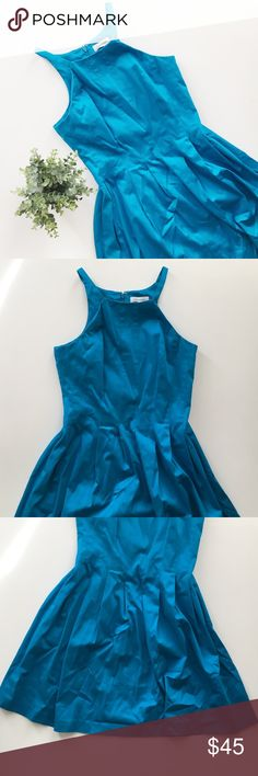 "Calvin Klein Fit & Flare Sleeveless Halter Dress Calvin Klein bright blue fit and flare sleeveless dress size 4 petite.  • High, halter neck • 35"" long, 15"" bust, 14"" waist • Not lined • Includes pockets • 98% cotton 2% spandex • No stains or holes, smoke and pet free home! Offers welcomed! Calvin Klein Dresses Mini"