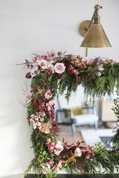 how to make this gorgeous holiday garland mirror with orchids and greenery   DIY tutorial on coco kelley