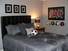 Mac's Room. Turned this little boy's room into a teen room for very little cost! Headboard from Weirs, Walmart bedding, reused dresser changed out the knobs, Target lamp, framed his favorite soccer logos above the bed.