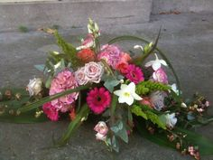 bloemstuk maar dan met paars/blauw ipv roze