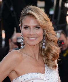Heidi Klum was simply a vision at the premiere of 'Nebraska' where she styled her hair into gorgeous cascading waves and a deep side part. #Cannes2013
