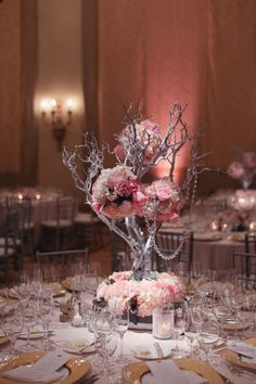 if i use silver in the color scheme, i could use my silver tree on the head table. Great idea for a wedding reception for the center piece!