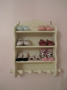 Vintage spice rack for baby shoes. Good idea. I would have never thought of it.