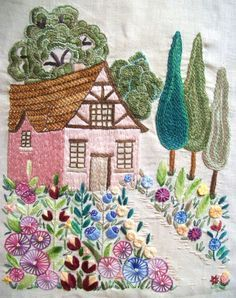 Hand embroidered scene with beautiful flowers in colorful bloom ! Nice choice of stitches, too, to create texture .
