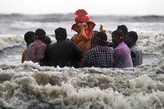 Devotees carry Lord Ganesh for immersion into the sea as part of a ritual during Ganesh Chaturthi celebrations, Mumba. Divaykant Solanki