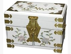 """Oriental Furniture Fine Quality Gift Ideas for Her Under 200, 14-Inch Daisy Fine Lacquered Jewelry Box Chest, White by ORIENTAL FURNITURE. $163.00. Browse our vast selection of japanese and chinese décor, art, lamps and gifts on amazon.com. Measures 14"""" wide by 9"""" deep by 10"""" tall, beautiful shang dynasty design jewelry case w/mirror. Fine hand crafted all wood chest w/mirror top and 3 hidden drawers, rich red plush felt lining. Extraordinary 12 coat white lacquer finish, beau..."""