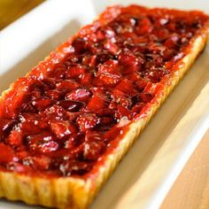 """Two rectangle raspberry rhubarb tarts made """"speed scratch"""" with prepared pastry dough, ripe rhubarb, fresh raspberries, fragrant orange zest, and crystallized ginger."""