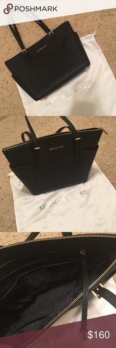 """Michael Kors Jet Set Leather Tote Authentic Michael Kors Jet Set Tote, genuine leather in black color, like new condition, shinny hardware, with the dust bag. The only missing part is the MK chain. 16""""W x 5.5""""D x 11.5""""H; 7"""" handle drop Michael Kors Bags Totes"""