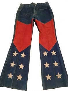 Vintage 1960s Hippie RWB w Stars Counter Culture Suede Leather Motorcycle Pants. The Woodstock era fashion trend once again finds my collection - to go with the RWB suede vests, hippie brimmed hat, sash and tote bag. The pants have been hard to find. Have wear and tear from use - but now have a complete ensemble. Peace and love brother!