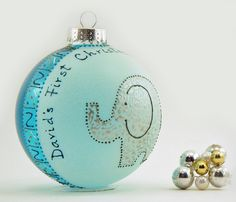 Baby's First Christmas - Personalized custom hand painted glass ornament (large) - Adorable elephant - Turquoise ball.  via Etsy.