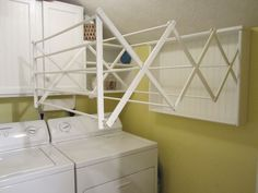 laundry room drying racks wall mounted | Found on homestagingbloomingtonil.wordpress.com