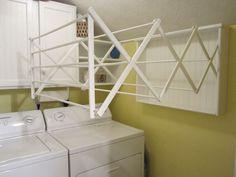 laundry room drying racks wall mounted | Found on homestagingbloomingtonil.wordpress.com