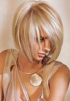 Sleek bob cut. Love the color!!!