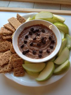 """Healthy """"Reese's Dip"""" 1 can of navy beans (or other white beans of choice) rinsed and drained, 1/3 cup all natural peanut butter, 1 teaspoon of vanilla extract, 2-3 Tbs of unsweetened cocoa powder, and stevia and honey to taste. Mix together in food processor or blender until smooth and serve with graham crackers and apple slices. Yum!"""