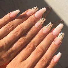 Nude coffin nails with gold accents