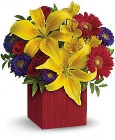 Send the spirit of summer to someone special with this bamboo box of bold blooms! Sure to brighten anyone's day, this all-occasion favorite is a top pick for men and women alike.