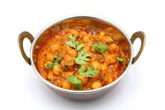 Recipe for Chana Masala. This classic North Indian vegetarian dish is a delicious way to boost your intake of protein and fibre-rich chickpeas. Indian Vegetarian Dishes, Vegetarian Recipes Easy, Indian Food Recipes, Great Recipes, Ethnic Recipes, Recipe For Chana Masala, Pickled Shallots, Pakistan Food, Masala Spice