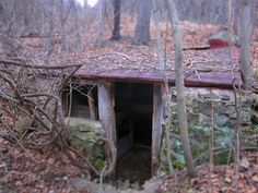 Sights of Appalachia....root cellar...my dad built one here in TN. You can the poor boy out of the hills....but cant get the hills out of the boy. Love my coal mining, swingin bridge walkin, moonshine makin, banjo picking hill family