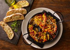Paella Valencia- saffron-braised chicken, shrimp, mussels, clams, Spanish sausage, bomba rice, piquillo pepper