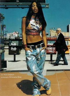 Baggy jeans and tight tank top screams female hip hop fashion back in the 90s, this classic tomboy look was worn by the Amazingly talented RnB singer Aaliyah