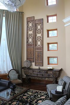 In the living room these two tall antique Chinese doors definitely draw plenty of attention, but they are not the focus of the room. The overall goal of the Green Antique design team is to include Chinese antiques into a Western-style home. Several antiques are featured in the home, yet the house does not seem overwhelmingly fragile (like antiques).