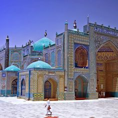 Afghanistan -- The Blue Mosque, in Mazar-e-Sharif, has tiles that look like they are painted with flowers, but the floral patterns are actually made from tiles cut into different shapes and plastered together.