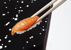 "Sushi Nakazawa: In this West Village sushi restaurant, ""everyone gets the same thing: omakase. There is no soy sauce for dipping; only freshly pickled ginger and a wet cloth, so you can eat the traditional way, with your fingers. But this is not a hushed temple—Nakazawa starts cracking jokes before the first piece of salmon hits a granite slab."""
