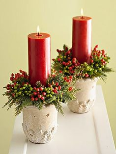 Berry rings sit atop ceramic planters, and create a beautiful frame for tall pillar candles.