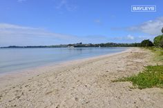 Snells Beach, a popular swimming beach for families. You will find this beauty approx an hour north of Auckland, New Zealand.