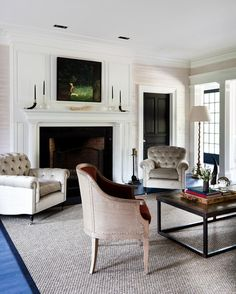 Transitional Living Room by Thom Filicia Inc. if you've got a big fireplace that's unlit 99.9 percent of the time, and a dark painting or flat-panel TV above it, a black door will help mitigate the impact of those big, black voids, so they don't look as noticeable in the room