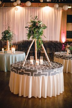 Innovative teepee floral table decor by Poppy Lane Design and Gibson Events. Rentals from Marianne's Rentals and Innovative Event Solutions. Photo by Josh McCullock Photography. #wedding #decor #centerpiece #teepee